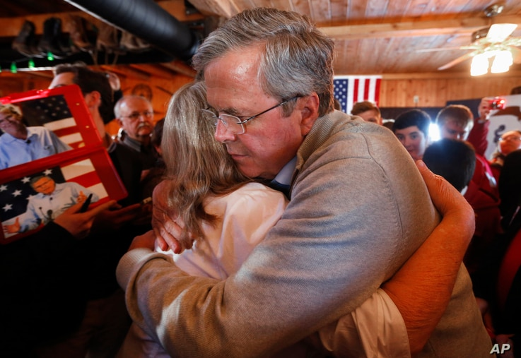 Former Florida Gov. Jeb Bush, a candidate for the Republican presidential nomination in 2016, hugs an audience member during a campaign event at Greasewood Flats Ranch in Carroll, Iowa, Jan. 29, 2016.