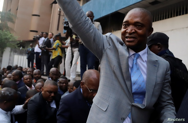 Former Congolese Interior Minister Emmanuel Ramazani Shadary waves to his supporters as he arrives to file his candidacy for the presidential election, at the Congo's electoral commission head offices at the Gombe Municipality in Kinshasa, Democratic...