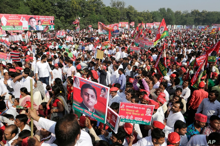 Samajwadi Party supporters hold the poster of their leader Akhilesh Yadav for the launch of the party's election campaign for the state of Uttar Pradesh, in Lucknow, India, Nov. 3, 2016.