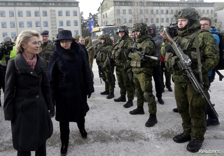 FILE - German Defense Minister Ursula von der Leyen, left, and Lithuania's President Dalia Grybauskaite attend a ceremony to welcome the German battalion being deployed to Lithuania as part of NATO deterrence measures against Russia in Rukla, Lithuan...