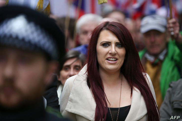 FILE - Jayda Fransen, acting leader of the far-right organization Britain First, marches in central London, April 1, 2017.