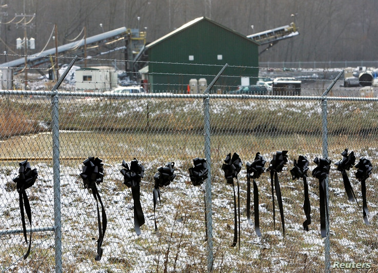 FILE - Twelve ribbons line a fence in front of the Sago Mine in Sago, West Virginia, Jan. 8, 2006. The ribbons honor the 12 miners who died in the Sago Mine after an explosion on January 2.