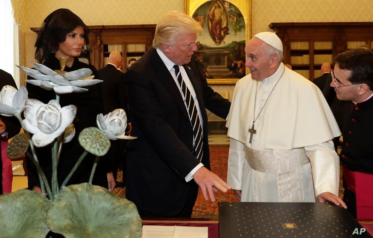 Pope Francis exchanges gifts with President Donald Trump and First Lady Melania Trump, on the occasion of their private audience, at the Vatican, May 24, 2017.