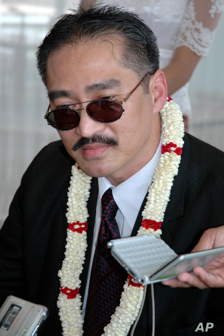FILE - Khmer Republican Party of Cambodia President Lon Rith, son of Lon Nol who ruled Cambodia from 1970 to 1975, talks to reporters on his arrival at Phnom Penh International Airport in Phnom Penh, Cambodia, April 20, 2008.