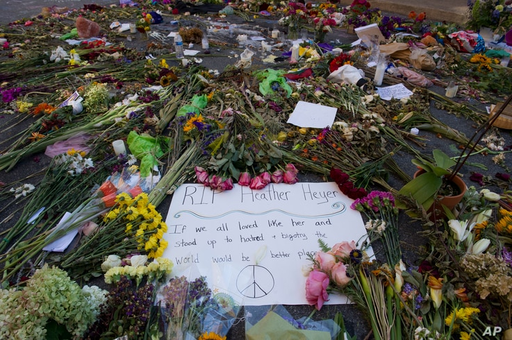 Notes and flowers form a memorial in Charlottesville, Va., Aug. 18, 2017, at the site where Heather Heyer was killed. Heyer was struck by a car while protesting a white nationalist rally on Aug. 12.