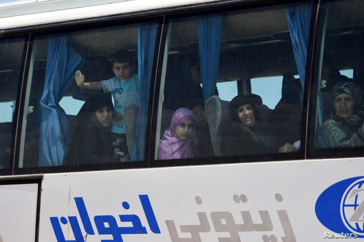 People are seen in the bus released by militants from Idlib, Syria May 1, 2018. (SANA/Handout via Reuters)