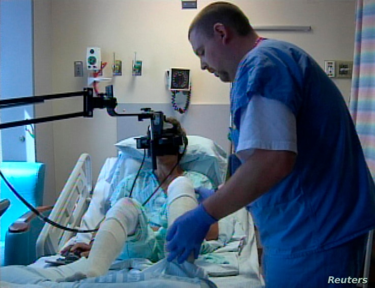 FILE - A hospital patient uses virtual reality treatment for pain in this undated photo.
