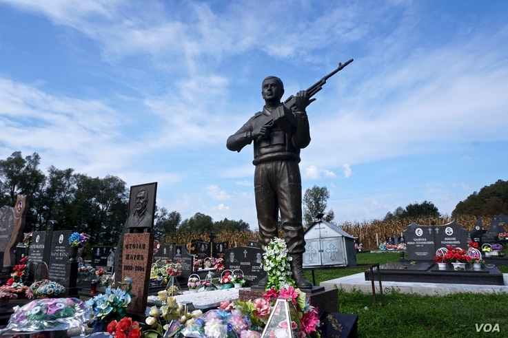 The grave of a Bosnian Serb soldier. All sides are meticulous in tending the graves of the dead from the Balkan wars of the 1990s that erupted as Yugoslavia fractured.