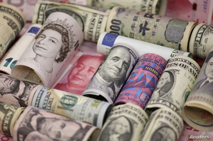 Euro, Hong Kong dollar, U.S. dollar, Japanese yen, British pound and Chinese 100-yuan banknotes are seen in a picture illustration shot, Jan. 21, 2016.