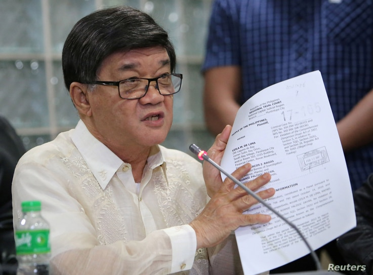 Philippine Justice Minister Vitaliano Aguirre shows the documents filed in the local court against Senator Leila de Lima during a news conference at the National Bureau of Investigation (NBI) headquarters in metro Manila, Philippines Feb. 17, 2017.