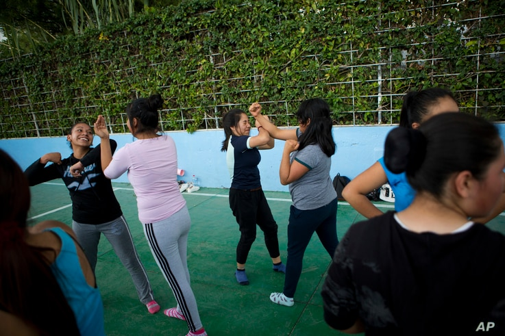 Female students take self-defense classes in Nezahualcoyotl, Mexico state, Aug. 25, 2017.