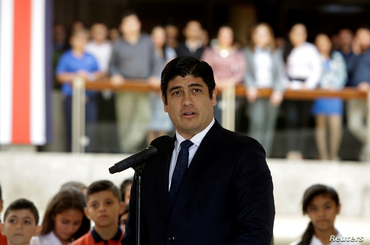 FILE - Newly-elected President Carlos Alvarado Quesada speaks during a welcome ceremony at the presidential house in San Jose, Costa Rica, April 18, 2018.