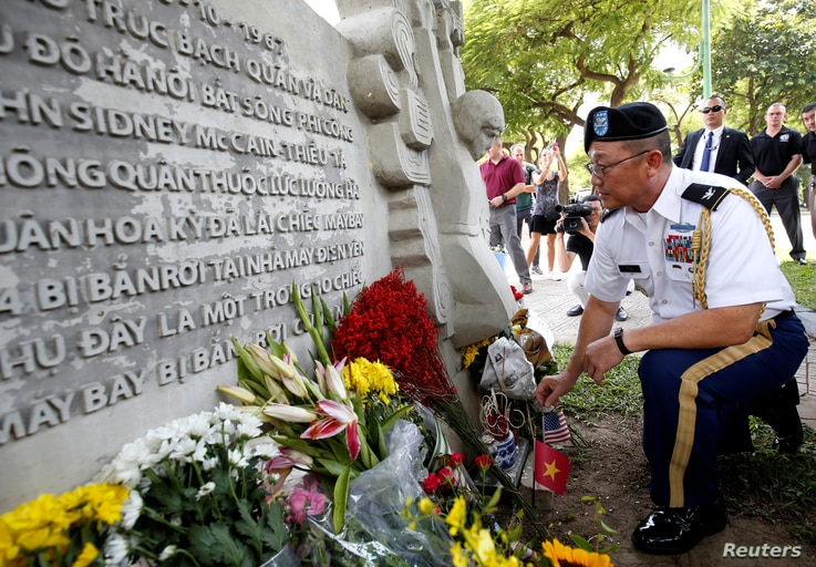 Military Attache Ton Tuan from U.S. Embassy places incense while he pays respect in memory of the late U.S. Senator John McCain (R-AZ) at the McCain Memorial in Hanoi, Vietnam, Aug. 27, 2018.