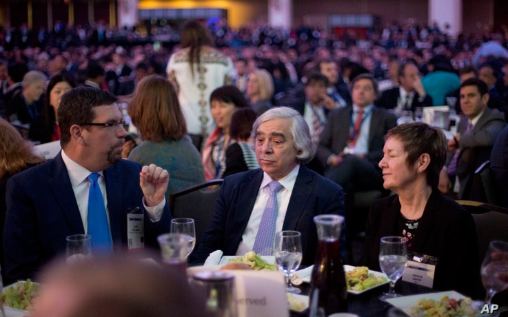 Energy Secretary Ernest Moniz, center, sits with other guests at the SelectUSA investment summit in Washington, June 20, 2016.