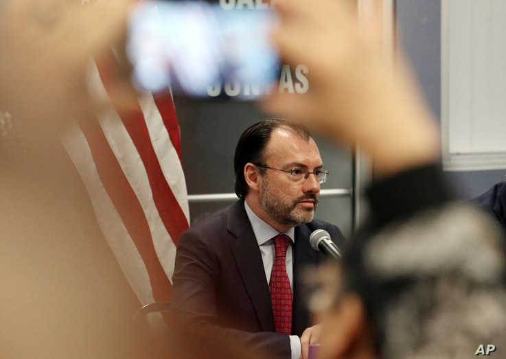 A visitor takes a phone photo of Mexico's Secretary of Foreign Relations Luis Videgaray at the Consulate General of Mexico in Los Angeles, Sept. 12, 2017. Videgaray announced support for young immigrants whose protection from deportation is being ter...