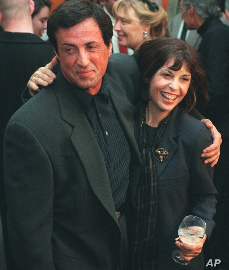 """FILE - Sylvester Stallone poses with """"Rocky"""" co-star Talia Shire before a screening of the film to celebrate its 20th anniversary, Nov. 15, 1996, at the Academy of Motion Picture Arts & Sciences."""
