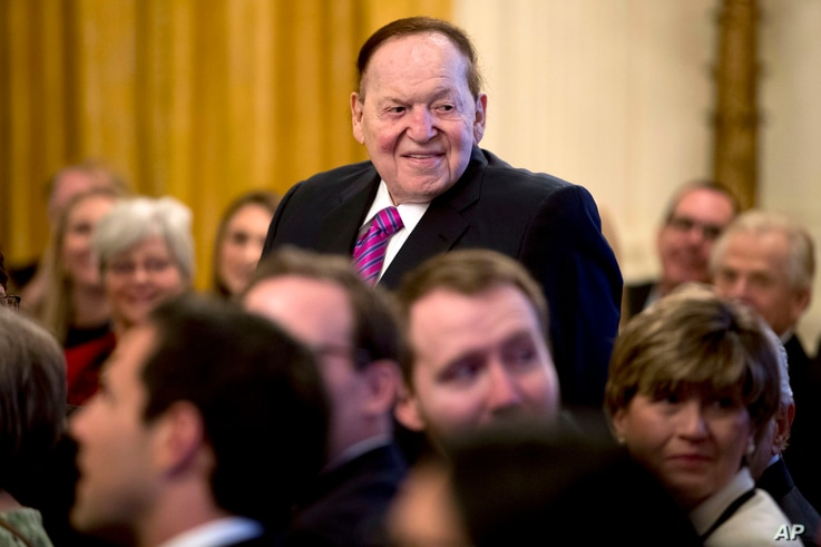 FILE - Las Vegas Sands Corp. Chief Executive and Republican donor Sheldon Adelson stands as he is recognized by President Donald Trump during a Medal of Freedom ceremony in the East Room of the White House in Washington, Nov. 16, 2018.