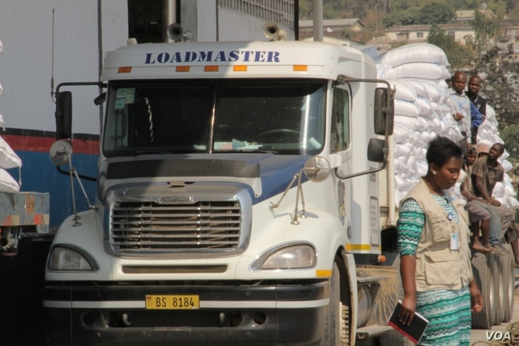 For the past three years, over half of Malawi's population has been relying on food aid such as the maize loaded on this truck at the WFP warehouse in Blantyre. (Photo: Lameck Masina for VOA)