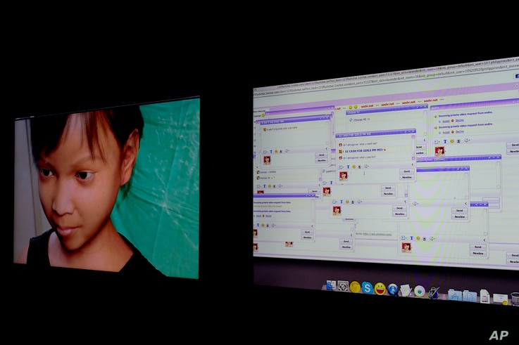 Persons solicit a purported 10-year-old Filipino girl, shown at left in a computer-generated image, through a public chat room, right, while actually chatting to a Terre des Hommes researcher during a media opportunity in Amsterdam, Netherlands in No...