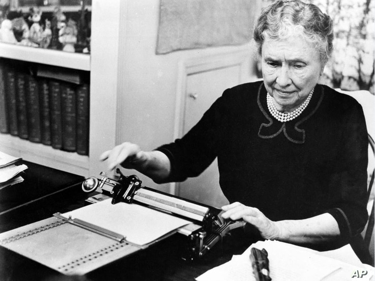 """FILE - Author and humanitarian Helen Keller, deaf and blind since childhood, appears in """"The Unconquered,"""" June 18, 1954. Also known as """"Helen Keller in Her Story,"""" the documentary film won a 1955 Academy Award. (AP photo)"""