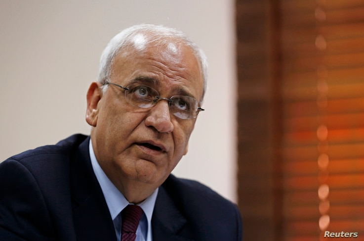 FILE - Palestinian chief negotiator Saeb Erekat speaks during an interview with Reuters in Ramallah, Aug. 11, 2013.
