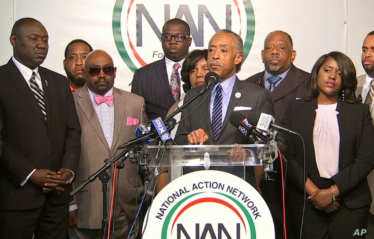 The Rev. Al Sharpton, center, speaks to the media at the National Action Center in New York, Sept. 21, 2016 about the shooting death of Terence Crutcher in Tulsa, Oklahoma, on Sept. 16, 2016.