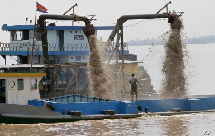 FIEL -A Cambodian man controls pumps mounted on a ship to dredge sand in the middle of the Mekong River near Phnom Penh, Cambodia, Oct. 9, 2011.
