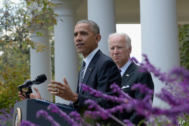 President Barack Obama, accompanied by Vice President Joe Biden, speaks about the election results in the Rose Garden at the White House in Washington, Nov. 9, 2016.