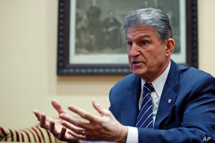 FILE - In this Feb. 1, 2017 file photo, Sen. Joe Manchin, D-W.Va. is interviewed by The Associated Press in his office in Washington.
