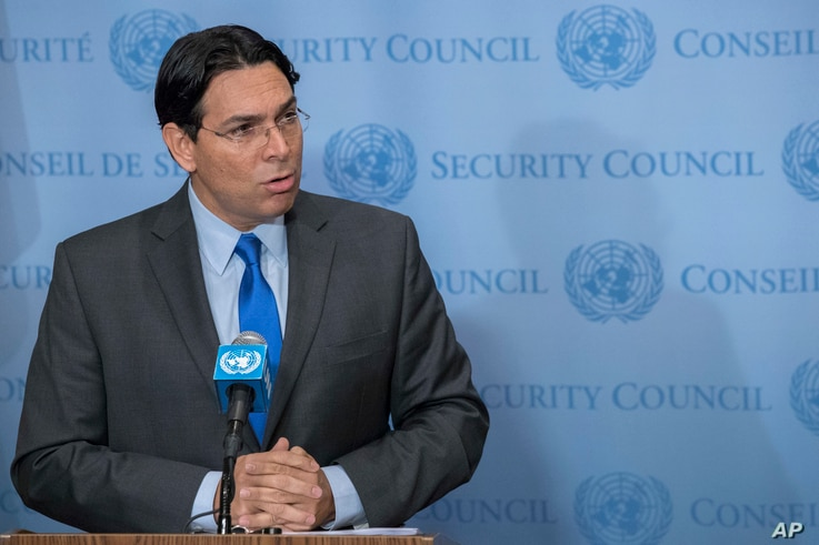Israel's Ambassador Danny Danon speaks to reporters outside the Security Council chambers, July 24, 2017 at United Nations headquarters.
