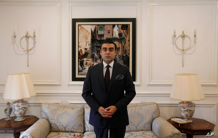 Russia's honorary consul, Mohammad Arsallah Khan poses for the Associated Press in Islamabad, Feb. 26, 2018.