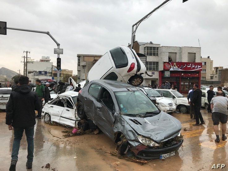 An image made available by Iran's Mehr news agency on March 25, 2019, shows flood-strewn cars piled up in a street in the southern city of Shiraz.