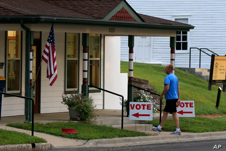 A voter enters City Hall in Lecompton, Kansas, to vote in the state's primary election, Aug. 2, 2016.