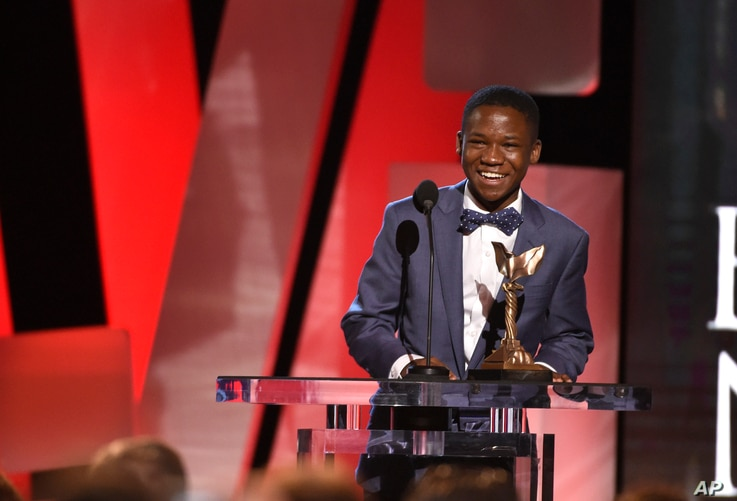 """Abraham Attah accepts the award for """"Beasts of No Nation"""" at the Film Independent Spirit Awards, Feb. 27, 2016, in Santa Monica, California."""