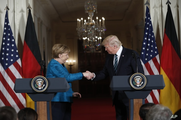 President Donald Trump and German Chancellor Angela Merkel shake hands at a joint news conference in the East Room of the White House in Washington, March 17, 2017.