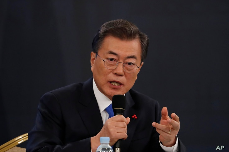 South Korean President Moon Jae-in answers reporters' question during his New Year news conference at the Presidential Blue House in Seoul, South Korea, Jan. 10, 2018.