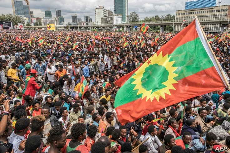 FILE - People gather to celebrate the return of the formerly banned anti-government group the Oromo Liberation Front (OLF) at Mesquel Square in Addis Ababa, Ethiopia, Sept. 15, 2018.