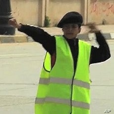 A young Boy Scout directs traffic in Benghazi, March 7, 2011
