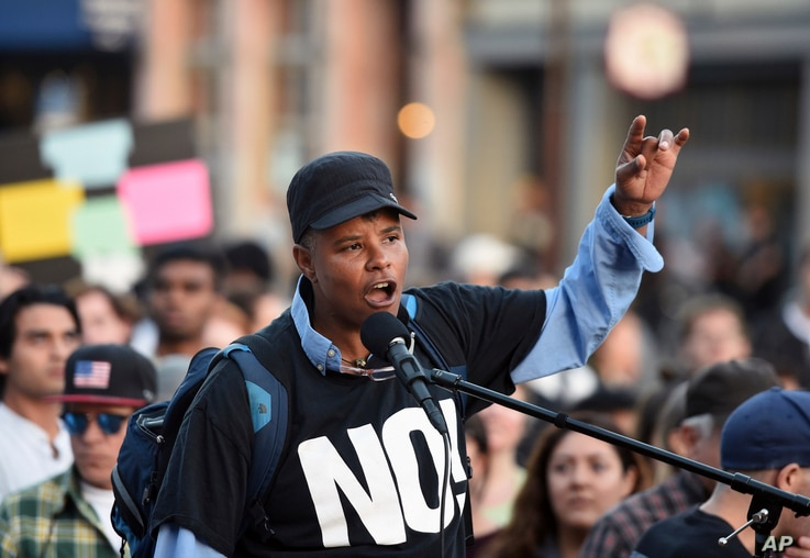 Xothitl Johnson addresses a crowd of protesters before a speech by Ben Shapiro on the campus of the University of California in Berkeley, Calif., Sept. 14, 2017. Several streets around campus were closed off Thursday with concrete and plastic barrier...