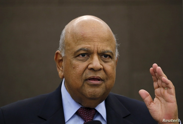 South African Finance Minister Pravin Gordhan reacts during a media briefing in Sandton near Johannesburg March 14, 2016.