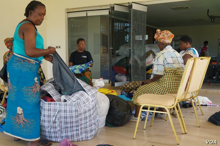 Volunteers sort donated clothes at Abida Mia's house in Blantyre, Malawi.