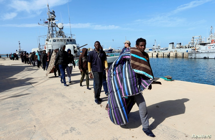 Migrants arrive at a naval base after they were rescued by the Libyan coast guard in Tripoli, Libya March 13, 2018.