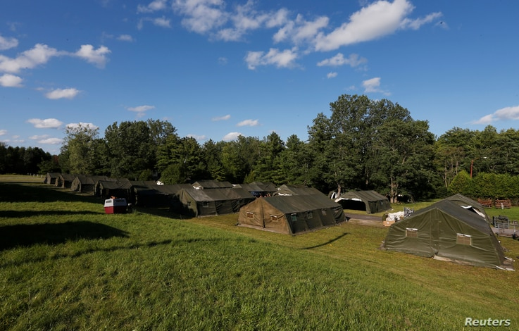 Tents are erected by the Canadian Armed Forces to house asylum seekers at the Canada-U.S. border in Lacolle, Quebec, Aug. 9, 2017.