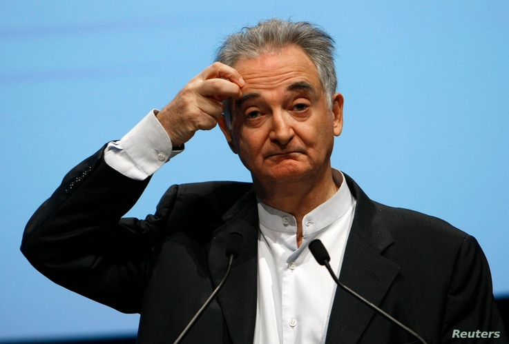 FILE - French economist Jacques Attali delivers a speech during a conference, Oct. 19, 2009.