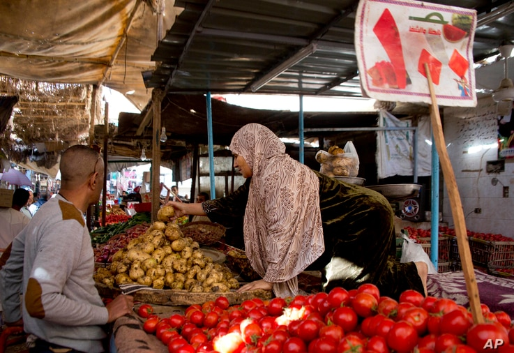 A vegetable vendor sells produce at a market in Cairo, Egypt, Jan. 10, 2017.