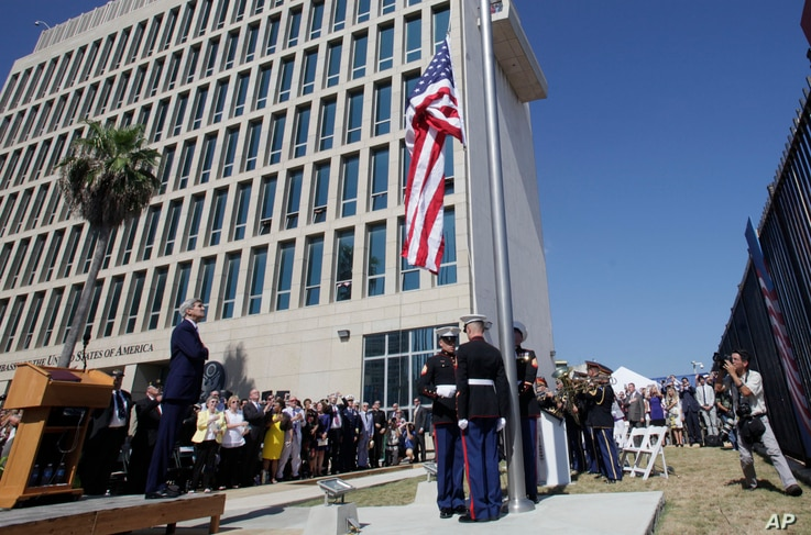 U.S. Secretary of State John Kerry watches the raising of the American flag at the newly opened U.S. Embassy in Havana, Cuba, Aug. 14, 2015.