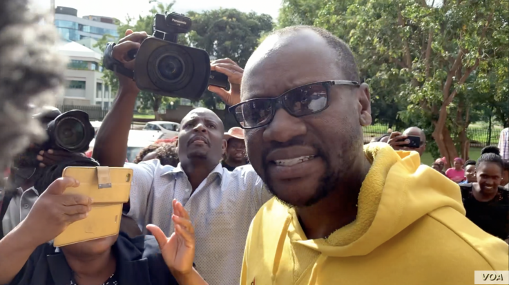 Pastor Evan Mawarire arrives at court in Harare, Jan. 17, 2019, after spending a night in jail on charges of inciting violence through social media. He is facing new charges of trying to subvert President Emmerson Mnangagwa's government, according ...