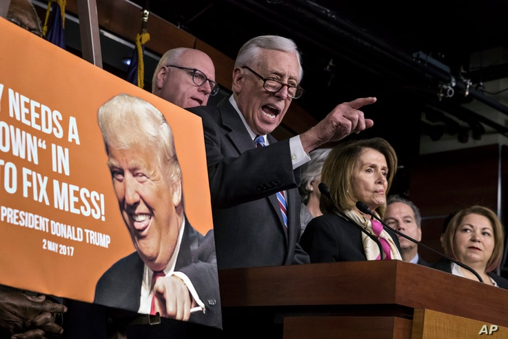 House Minority Whip Steny Hoyer, D-Md., center, joined from left by, Rep. Joseph Crowley, D-N.Y., House Minority Leader Nancy Pelosi, D-Calif., and Rep. Linda Sanchez, D-Calif., hold a news conference on the first morning of a government shutdown at ...