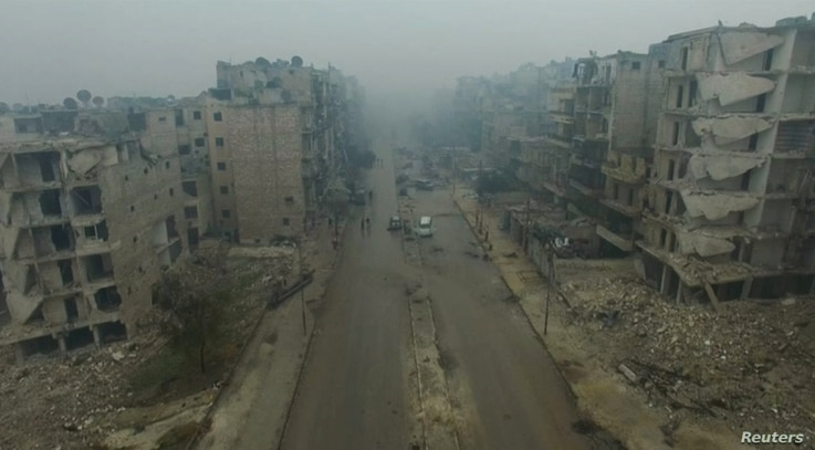 An image from video taken on Dec. 13, 2016 of a general view of bomb damaged eastern Aleppo, Syria in the rain