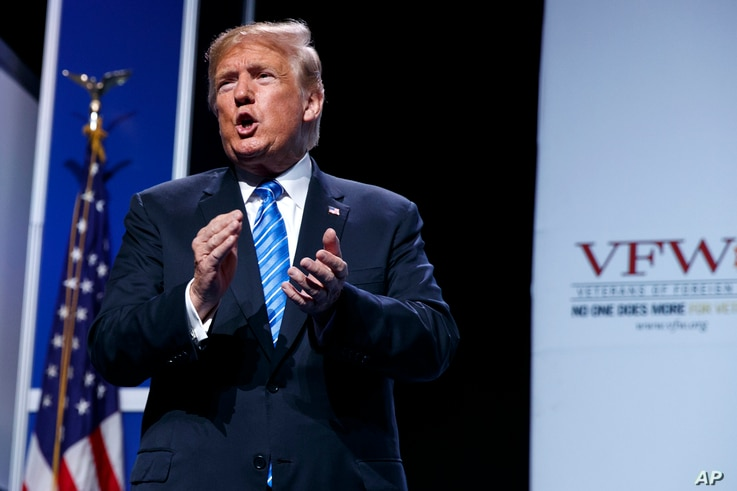 President Donald Trump walks off after speaking to the Veterans of Foreign Wars of the United States National Convention, Tuesday, in Kansas City, Mo.